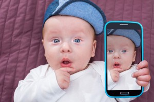 bigstock-Baby-boy-taking-selfie-with-a-104877596